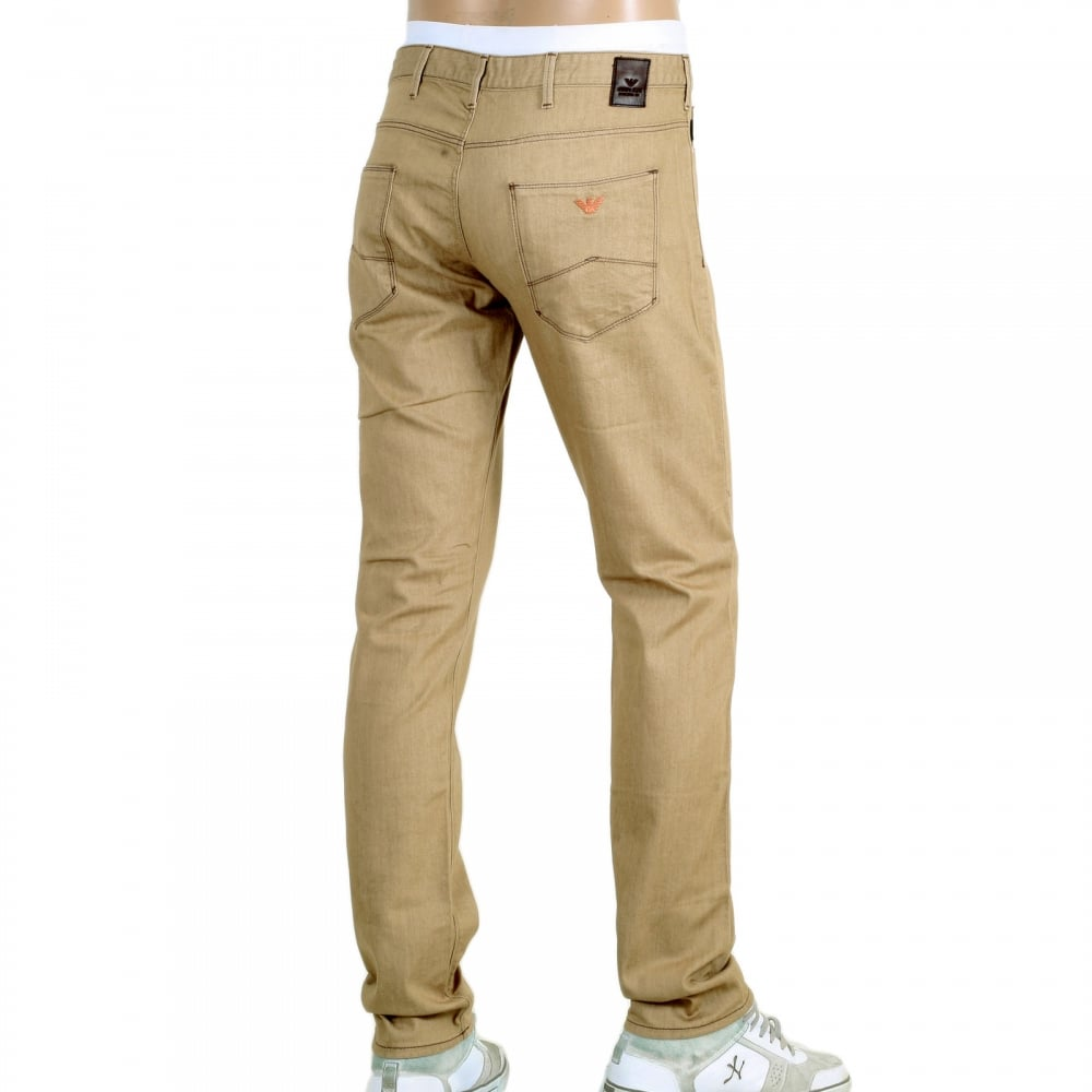 0374f69ac3ceb ARMANI JEANS Mens Low Waist Tight Leg J06 Slim Fit Jeans in Beige with  Brass Coloured Embossed Waistband Button and Rivets