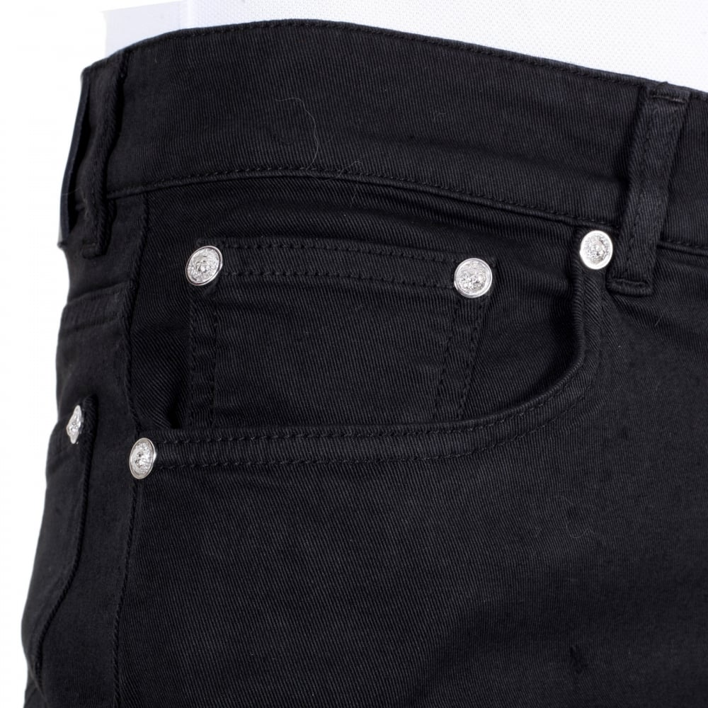 df086746 Silver Lion Studded Slim Fit Jeans for Men by Versace